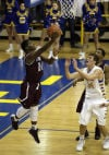 Bowman Academy guard Davon Dillard shoots in front of Carmel's Keegan Culp on Saturday. (copy)