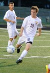 Chesterton's Billy Biehl tries to gain possession of the ball during Wednesday's game against Crown Point.