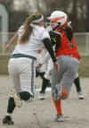 Whiting's Sydney Neyhart tags out Wheeler's Julia Taylor in a rundown Thursday.