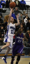 Lake Central's Tara Zlotkowski shoots over Merrillville's A.J. Downs on Friday.