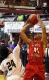 Homewood-Flossmoor's Malcolm Grady shoots against Thornwood's Kaliph Fagen in the Class 4A Thornton Sectional semifinal.