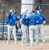 Lake Central's Brenden Seren is congradulated at home plate by his teammates after his grand slam Tuesday afternoon at Bishop Noll.