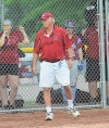 Hanover Central head coach Larry McMillian watches his player at the plate Tuesday night during the Class 3A regional championship against Griffith.