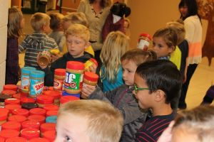 Students and staff donate food to needy
