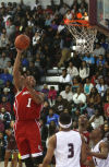 E.C. Central's Tre'Quan Burnett shoots against Bowman Academy on Tuesday night.