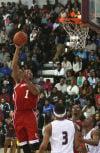 E.C. Central's Tre'Quan Burnett shoots against Bowman Academy on Tuesday night.