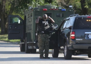 Officers shot, hostage standoff in Harvey closes nearby schools