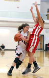 LaPorte's Kyleigh Kubik drives around Crown Point's Hannah Albrecht in the first half Friday night at the Class 4A Hobart Sectional.