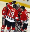Blackhawks beat Kings, get point in 15th straight 