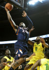 Illinois guard Rayvonte Rice drives to the basket on Oregon guard Mike Moser during the first half Saturday.