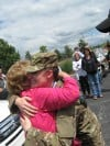 Big hugs for returning soldier