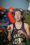 Marian Catholic's Caitlin Henry crosses the finish line at the Jimmy Daniels Invitational on Saturday.