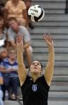 Lake Central's Stephanie Spigolon sets against Crown Point on Tuesday.