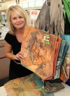 Walgreens program showcases artist's paintings on tote bags