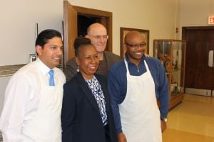 South suburban lawmakers volunteer at Catholic Charities supper