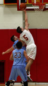 Andrean's Dane Chance past Hanover Central's Brandon Sears for a layup