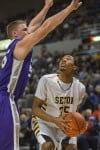 Seton's Johnny Patterson faces a tough defense from Harrisburg's Dakota Upchurch in the 2A state championship game.