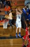 Lake Central's Matt Meneghetti shoots a 3-pointer against Morton's Darius Coty on Friday in the Class 4A West Side Sectional.