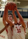 Crown Point's Leo Zdanowicz hauls down a rebound against Lake Central on Friday night.