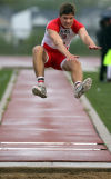 Portage's Nathan Cherry competes in the long jump during Wednesday's Duneland Conference meet at Crown Point.