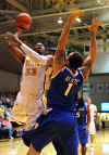 Valparaiso's Jubril Adekoya goes up a shot over Saint Louis' Grandy Glaze during the first half Saturday.