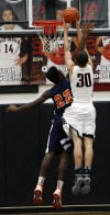 Lowell's Zach VanHook grabs a rebound over West Side's Marlon Northern on Saturday.