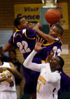 Gavit's Kyle Landers and Jeremy Irons plus Lew Wallace's Aarion Green battle for a rebound during semifinal play Friday at the Class 3A Hammond Sectional.
