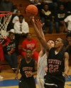 21st Century's Louis Brown scores over Pioneer's Matthew Dorris