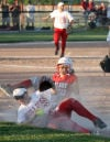Crown Point's Rachael Honaker gets the game's final out on Portage's Adrien Hall