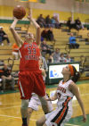 South Central's Riley Popplewell scores over Westville's Stephanie Popp during Tuesday's PCC tourney