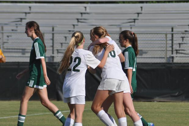 <p>Teammates congratulate Greer Moseley after scoring the lone goal of the Lady Spartans' win Wednesday.</p>