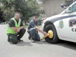 City puts 'boot' on car, owner pays old parking tickets right away