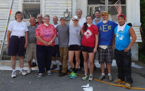 <p>City officials visited Teri Loetterle's home on W. 1st St. on Thursday to thank Reach Mission campers and staff for their hard work. A group of campers from New York and Pennsylvania spent much of the week scraping paint off the siding of Loetterle's home in preparation of a fresh coat of paint. More than 600 volunteers with the non-profit Christian organization worked in Fulton over the last two weeks, providing home repairs to 54 residences in the community at no cost to the homeowner.</p>