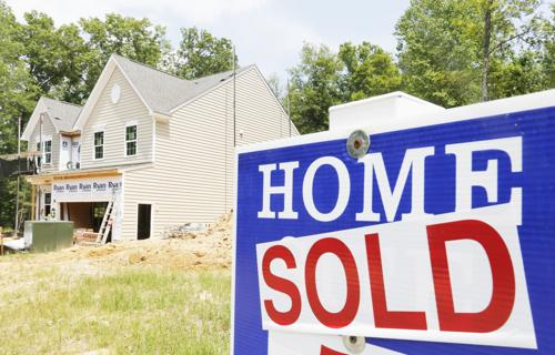 "<p class=""TXBody"">In this  2015 file photo, a sold sign is posted in front of a new home under construction in Mechanicsville, Va. While a national report indicated that home builder confidence is on the rise, local construction experts say the Oswego area is not reflective of that trend. </p>"