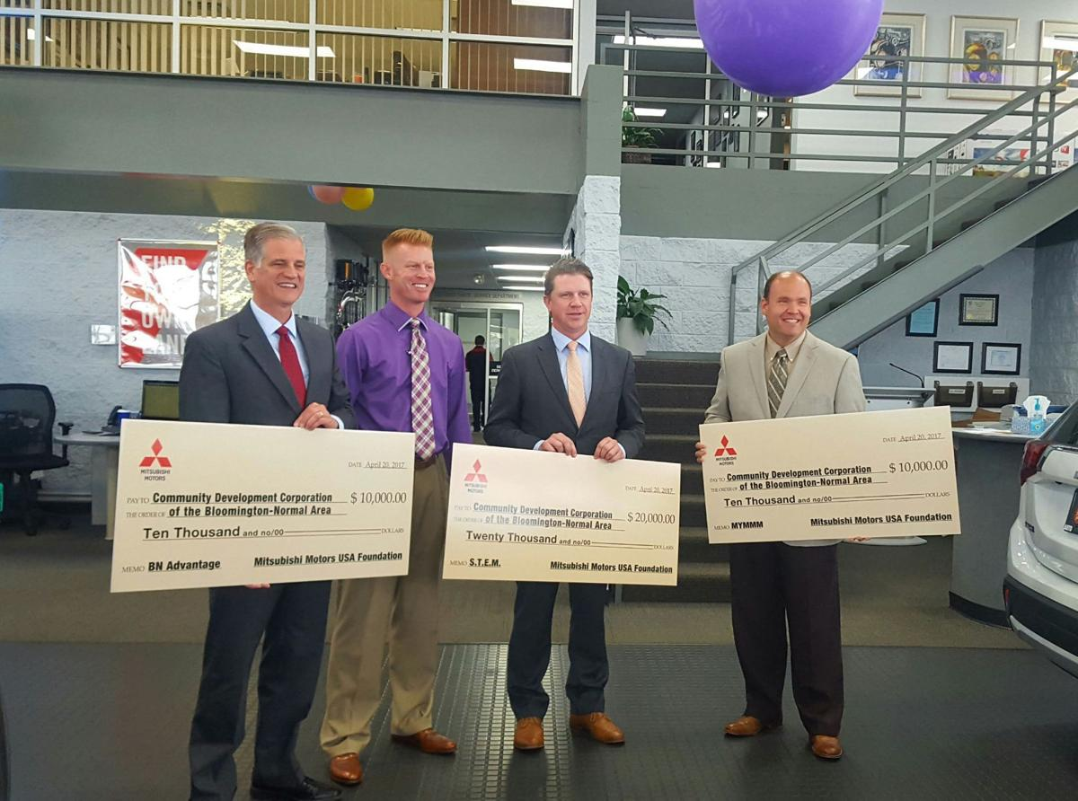 Twin city groups receive donation from mitsubishi for Mitsubishi motors bloomington il