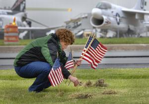 Photos: Volunteers place flags for Memorial Day