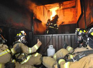 Photos: Elected officials experience real fire training