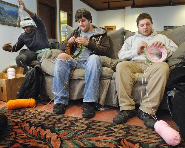 Group Of People Knitting : Bearded men knitting hats helping charities local