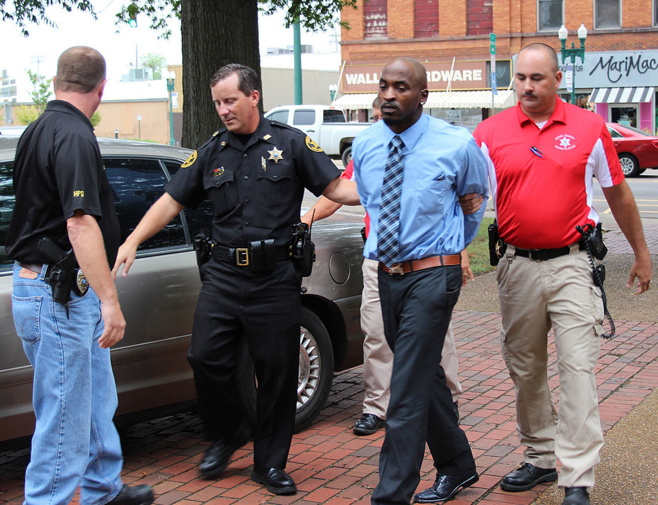 ... is escorted into the henry county courthouse friday morning by from