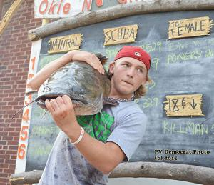 """<p><span>The big catch results are in for Pauls Valley's Okie Noodling Tournament. This young man was one of several competitors that attempted to take the top prize at the event last weekend in Wacker Park.</span>A full galllery of photos can be viewed and purchased at: <a href=""""http://photos.paulsvalleydailydemocrat.com/Events/Okie-Noodling-Tournament-2015/"""" target=""""_blank"""">http://photos.paulsvalleydailydemocrat.com/Events/Okie-Noodling-Tournament-2015/</a></p>"""