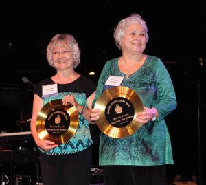 <p>Photo by David B. Strickland</p><p>Claudette Aycock, left, and Beverly Cronan, recently retired executive assistants with the Georgia Poultry Federation, were awarded with the federation's first ever Honorary Life Members of the Poultry Leaders Round Table for their long-time outstanding service to the GPF. They were recognized during the group's Night of Knights event on Aug. 15, in Atlanta, Ga.</p>
