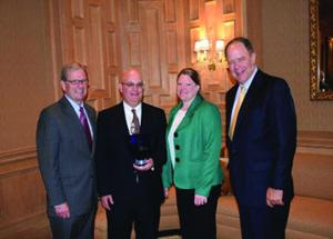 <p></p><p><strong>Member of the Year:</strong> The American Feed Insutry Association has named Dr. Charles Starkey as its Member of the Year. Pictured are, left to right, AFIA President and CEO Joel G. Newman, Starkey and his wife, Dr. Jessica (Dunn) Starkey and former chairman of the board Dr. Alan Wessler.</p>