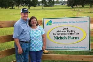 <p>Special</p><p>Robby and Kathy Nichols display their Alabama Poultry Farm Family of the Year sign at the gate to their Letohatchee, Ala., farm.</p>