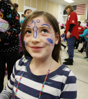 IN THE SCHOOLS CARNIVAL 100: Third grade student Camryn Mansfield had her face painted like a butterfly. The Glenwood Avenue Elementary School in Wildwood, celebrated the 100th Day of School with sports-themed activities held in the school's all-purpose room. Tuesday Feb. 11, 2014. (Dale Gerhard/Press of Atlantic City) - Dale Gerhard