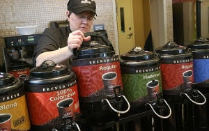WaWa: Fresh Food Manager Karen Wells of Galloway sets out a fresh thermos. Sunday April 13 2014 Customers buy coffee at the new WaWa on Rt 52 in Somers Point. WaWa will celebrate it's 50 year anniversary this week. (The Press of Atlantic City / Ben Fogletto) - Ben Fogletto