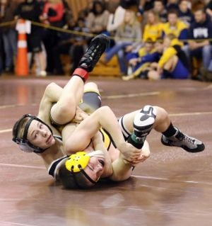 District 32 Wrestling: Kevin Thomas of Egg Harbor Township's, left in control over Alexander Pruszinski of Lower Cape May, right bottom during 106 lb. wrestling match at District 32 Wrestling Tournament at Absegami High School Friday, Feb 21, 2014. - Edward Lea