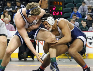 State Wrestling Tournament: Ed Shockley of Millville, right, and Micheal Oxley of Christian Brothers wrestle in the consolation semifinals of the State Individual Championship at Boardwalk Hall in Atlantic City on Sunday. Shockley defeated Oxley 3-1. - Ben Fogletto