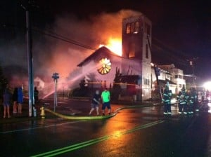 Fire: Fire rages at the Church of the Redeemer in Longport. A downed power line may have started the fire in the 104-year-old building.  - Photo by Sarah Watson
