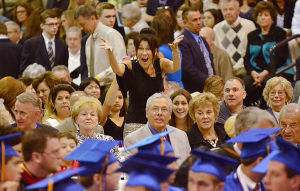 St. Augustine Graduation: Family members wave to graduates. Sunday May 19 2013 St. Augustine Prep Graduation. (The Press of Atlantic City / Ben Fogletto)  - Photo by Ben Fogletto