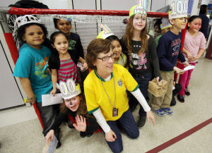 IN THE SCHOOLS CARNIVAL 100: First grade teacher Cindy Kurkowski poses with her students inside a hockey net at the school. The Glenwood Avenue Elementary School in Wildwood, celebrated the 100th Day of School with sports-themed activities held in the school's all-purpose room. Tuesday Feb. 11, 2014. (Dale Gerhard/Press of Atlantic City) - Dale Gerhard